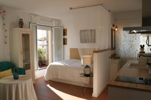 A bed or beds in a room at Ático con encanto