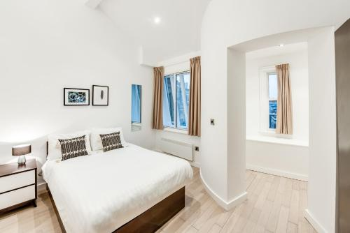 A bed or beds in a room at FM Living Apartments