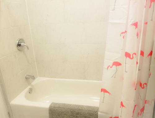 A bathroom at JstLikeHome - Downtown Suites