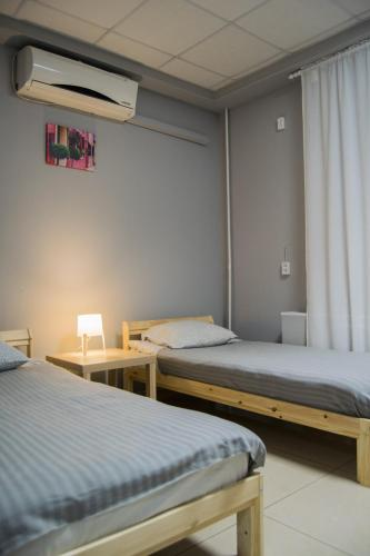 A bed or beds in a room at Mini Hotel by Riviera