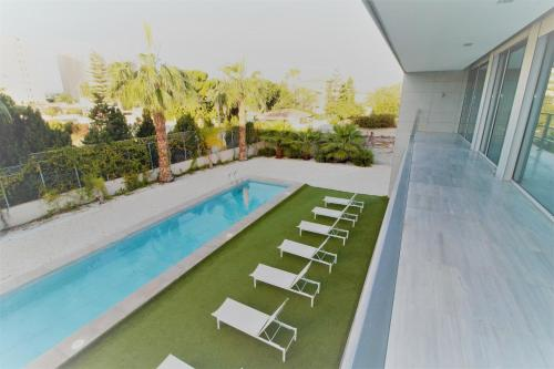 The swimming pool at or near Beach & Golf Luxury Villa Alicante
