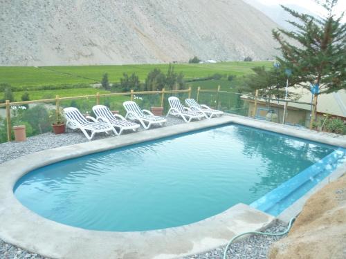 The swimming pool at or near Cabañas Utopia