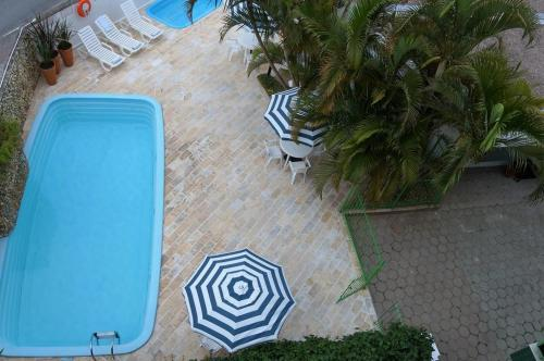 A view of the pool at Canna Verde Apart Hotel or nearby