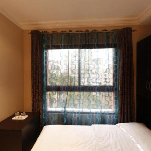 A bed or beds in a room at Hotel Dar El Ikram