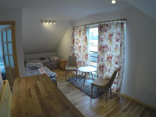 Posedenie v ubytovaní Apartmány Dúbrava