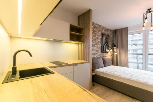 A kitchen or kitchenette at Urban Residence Apartments