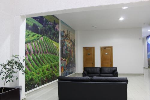 Zona de estar de Providencia Town Apartament