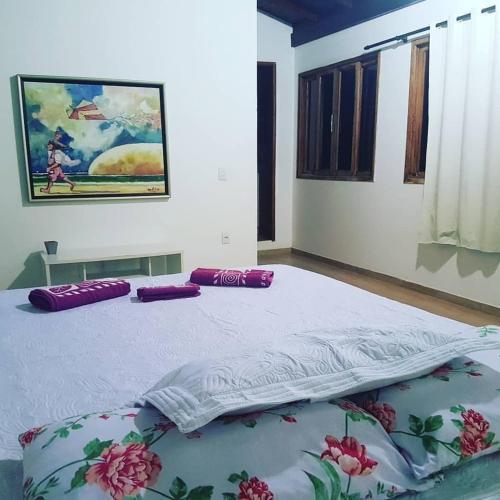 Cama o camas de una habitación en Hostel Ribeirão do Sol