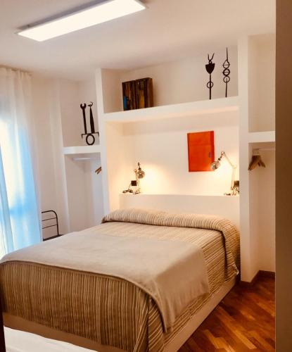 A bed or beds in a room at Camere Delle Rose