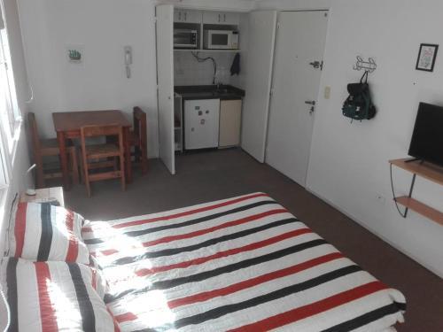 Una cama o camas en una habitación de Departamento Recoleta
