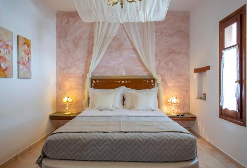 A bed or beds in a room at Niriides
