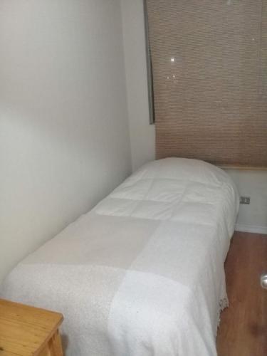 Cama o camas de una habitación en Departamento Central Santiago