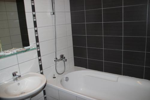 A bathroom at PM Services Borovets Garden Apartments