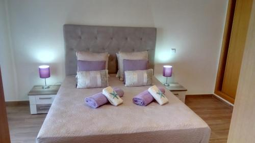 A bed or beds in a room at Albufeira Premium Apartment