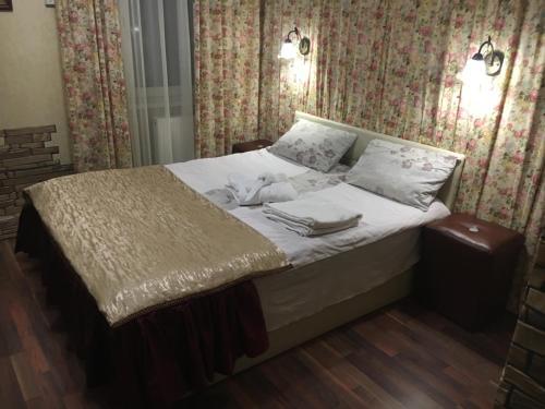 Кровать или кровати в номере Apartment on Bystry 6