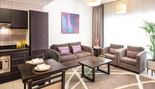 A seating area at Citadines Metro Central Apartments