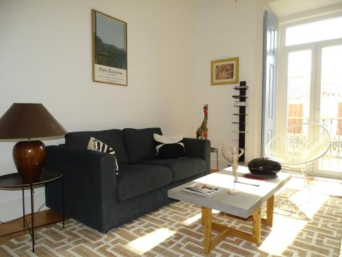 Een zitgedeelte bij Luxurious Apartment heart of Principe Real