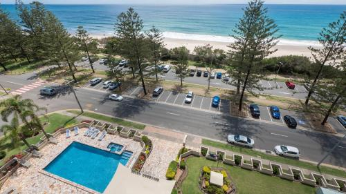 A view of the pool at Southern Cross Beachfront Holiday Apartments or nearby