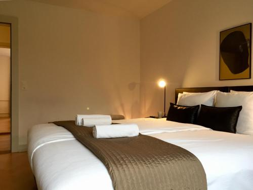 Ein Bett oder Betten in einem Zimmer der Unterkunft VIADUKT Apartments