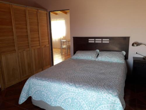 A bed or beds in a room at Loft Ckari