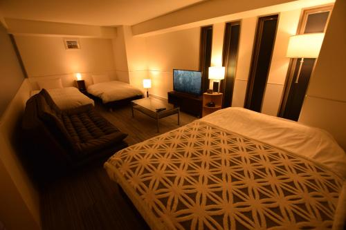 A bed or beds in a room at Residence Condominium KALAHAAI