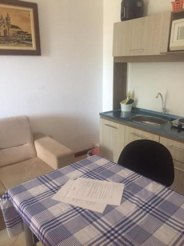 Una cocina o zona de cocina en Apartamento Com Vista Para a Mata