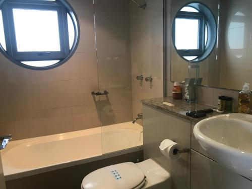 A bathroom at Serviced Apartments Sydney- Eclipse