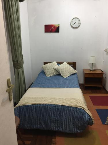 Cama o camas de una habitación en Arriendo Pieza Privada
