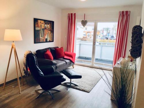Ein Sitzbereich in der Unterkunft Apartment Alleestraße