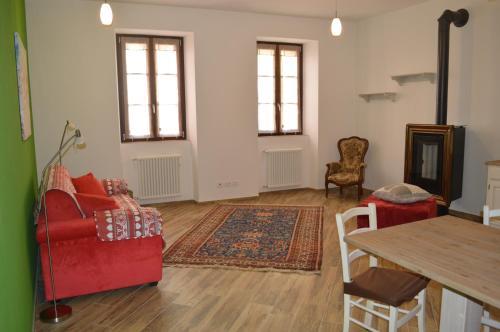 Area soggiorno di Parravicini Red Flower apartment