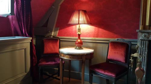 Ein Sitzbereich in der Unterkunft Parc Royal Appartements