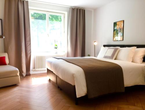 A bed or beds in a room at VIADUKT Apartments
