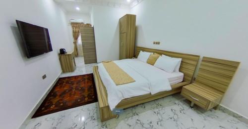 Cama o camas de una habitación en Centurion Apartment - Maitama