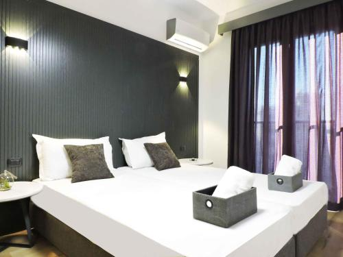A bed or beds in a room at Tirana LUX Apartments