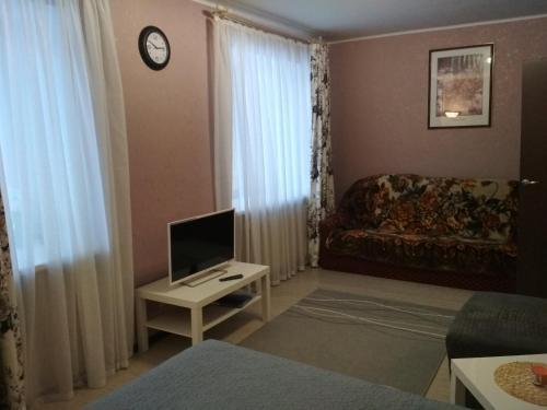 Гостиная зона в Apartments on pr. Aleksandra Nevskogo 43