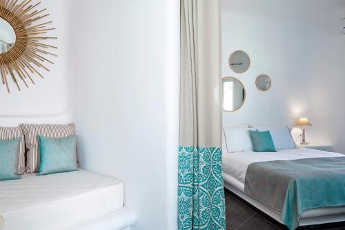 A bed or beds in a room at Colours of Mykonos Luxury Residences & Suites
