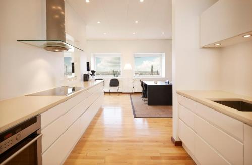 A kitchen or kitchenette at Europahuset Luxury Apartments
