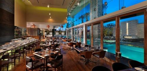 A restaurant or other place to eat at 35th Floor Stunning Palms Place Suite w/Balcony