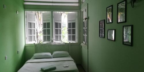 A bed or beds in a room at Dream Traveller Guest House