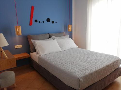 Ein Bett oder Betten in einem Zimmer der Unterkunft Art Apartment