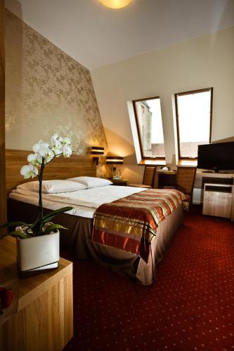 Łóżko lub łóżka w pokoju w obiekcie Duet Hotel