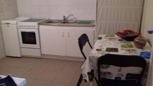 A kitchen or kitchenette at gîte vacances