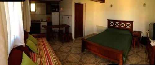 A bed or beds in a room at Cabañas Marias del Sur