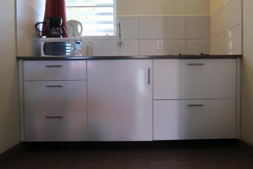 O bucătărie sau chicinetă la Cattleya Apartments Curacao