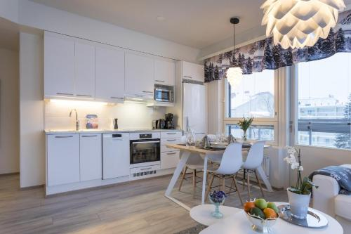 A kitchen or kitchenette at Tuomas´ luxurious suites, Ahola