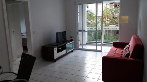 Zona de estar de Bem localizado com sacada, churrasqueira, garagem e split