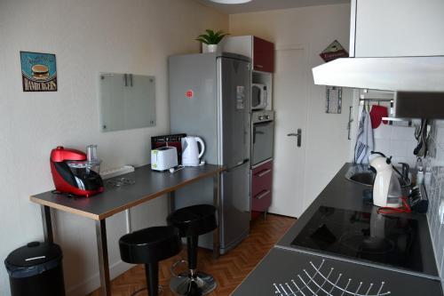 Cuisine ou kitchenette dans l'établissement Appartement Le Grand Parc