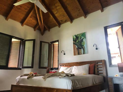 Ein Bett oder Betten in einem Zimmer der Unterkunft The Marine Park Cottage