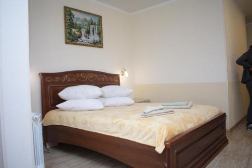 A bed or beds in a room at Apartments Rose Del Mare