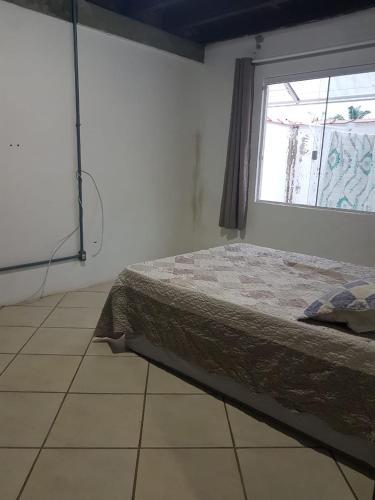 Cama o camas de una habitación en Quarto em Canasvieiras!!